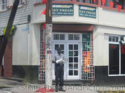 Poilice in uniform in front of Subway at Basseterre St Kitts.jpg