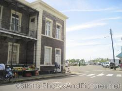 Fruit stands next to National Museum at Basseterre St Kitts.jpg