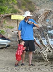 Darwin holds on to daddy at the Shipwreck Bar & Grill in St Kitts.jpg