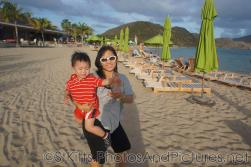 Darwin looking upset as mommy holds him at beach behind Carambola Restaurant in St Kitts.jpg