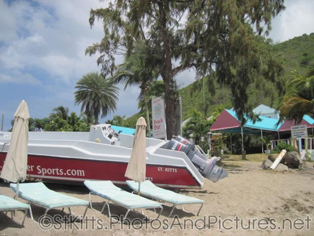 Motor boat parked on beach of Monkey Bar Beach in St Kitts.jpg