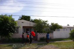 People of St Kitts walking on a sidewalk.jpg