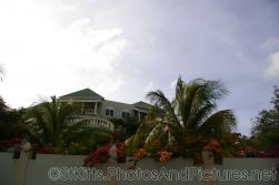 Large home with flowers pouring over walls in St Kitts.jpg