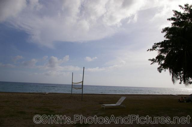 Empty beach chair and volley ball net at a beach in Frigate Bay St Kitts.jpg
