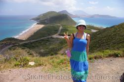 Joann at a hill top with view of ocean and sea in St Kitts.jpg