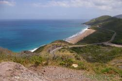 View of empty beach from hill top in St Kitts.jpg