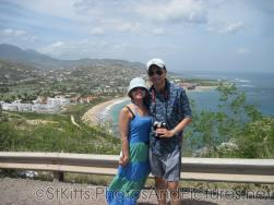 David and Joann with Frigate Beach in the background in St Kitts.jpg