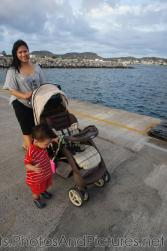 Darwin holds on to the stroller next to Mommy on cruise pier in St Kitts.jpg