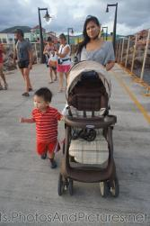 Darwin and mommy walking back to Norwegian Dawn on cruise pier in Port Zante St Kitts.jpg