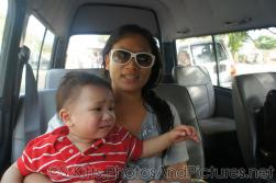 Darwin looks unhappy as mommy holds him in tour van in St Kitts.jpg