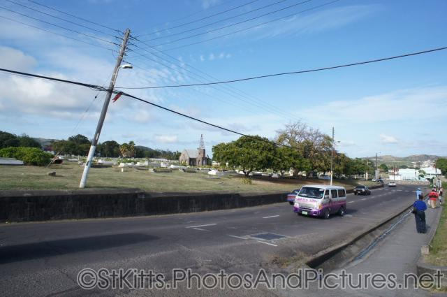 Street next to cemetary in International University of the Health Sciences School of Medicine in St Kitts.jpg