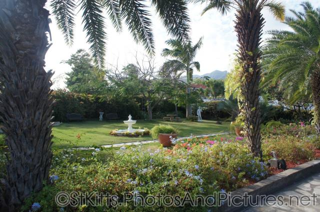 White fountain at Palm Court Gardens in Fortlands St Kitts.jpg